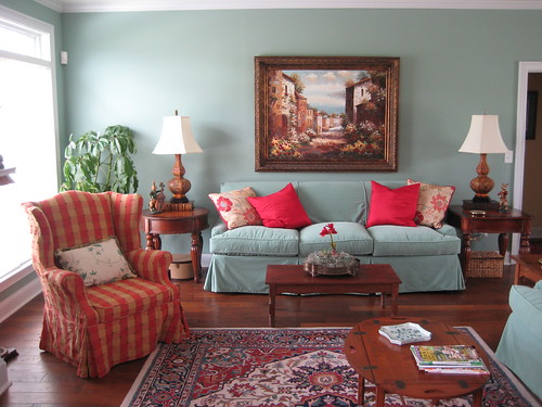 Living room with vintage and new; custom slipcovers on old and new furniture, vintage oriental rug, custom pillows from designer fabrics