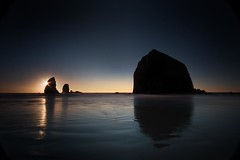 Canon Beach (Jeff Engelhardt) Tags: ocean blue sunset orange reflection water yellow oregon photoshop canon sand waves pacific wideangle timeexposure adobe haystackrock 1022mm silhouetted hdr highdynamicrange pacificcoast starburst canonbeach 40d blendif ronbigelow