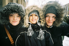 three girls (-Antoine-) Tags: winter canada film analog 35mm fur iso100 lomo lca fuji montral quebec plateau montreal coat hiver january jacket qubec hood invierno 100 analogue ge veronique janvier vero 2009 tuque genevive vronique genevieve clarisse boulet fourrure plateaumontroyal papineau hooded fujicolor capuchon capuche lca2 lomokompactautomat vr lomocompactautomat capuches capuchons f1000028 antoinerouleau