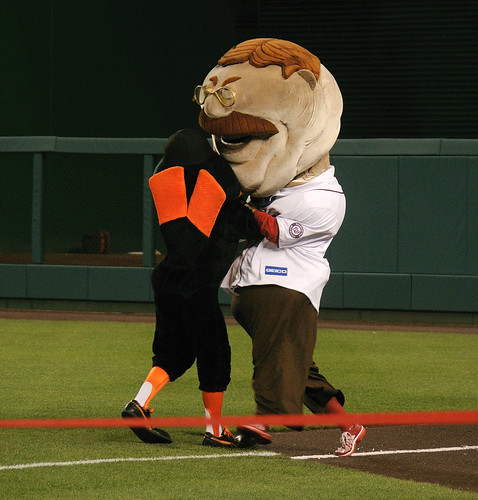 Teddy Roosevelt tackles the Orioles Bird during the presidents race at Nationals Park