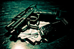 Guns N Greed (Keon/ M.O.C. Photography) Tags: money dark nikon darkness evil criminal crime guns bullets taurus weapons firearms d40 keonwinston