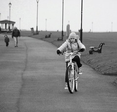 Girl on a bike (debfreemansmudge) Tags: street cold girl person ride young biker streetphotographer