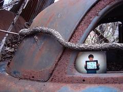 carriage art (zen) Tags: boy usa abandoned car vines artwork junk rust automobile photos asheville rusty northcarolina photographs 2p rephotograph carrierpark zensutherland photographinmatrix 20080314 googleavl