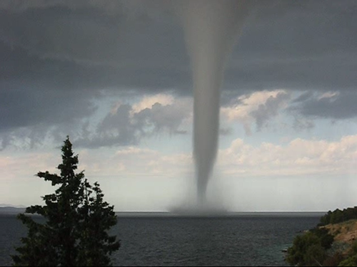 """waterspout tornado Waterspouts are called """"tornadoes over water"""" for a reason: visually, they sport the same telltale vortex, and they operate under the same principles."""