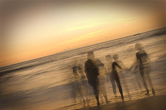 People and Their Souls (Chitra Aiyer) Tags: longexposure sunset sea sky people sunlight water photoshop children waves candid tripod goa kitlens dslr chitra arabiansea explored femalephotographer canon400d canondigitalrebelxti chitraaiyer ladyphotographer onexplorejun7200845 chitraaiyerphotography femaleindianphotographer