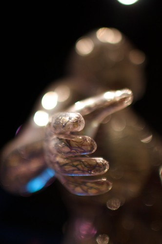 The hand emerges from the Bokeh Beast