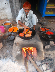 Orange (Raja Islam) Tags: pakistan orange cooking hair candy desert sweet cook sind sindh thar nagar mithai methai nagarparkar parkar jalaybi jalayb