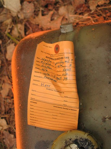 Evidence tag on the oil jug