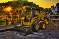 Sunrise - Time to Work (Thad Roan - Bridgepix) Tags: street sun sunlight tree green industry yellow sunrise construction colorado industrial denver equipment explore sidewalk pile loader hdr komatsu gravel littleton photomatix 200808