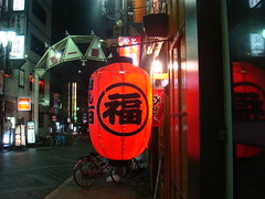 Red Lamp District (crystoforo) Tags: red streets reflection bicycle night train walking tokyo ikebukuro lantern wandering top36 top50 laststop topfavorite topphotos