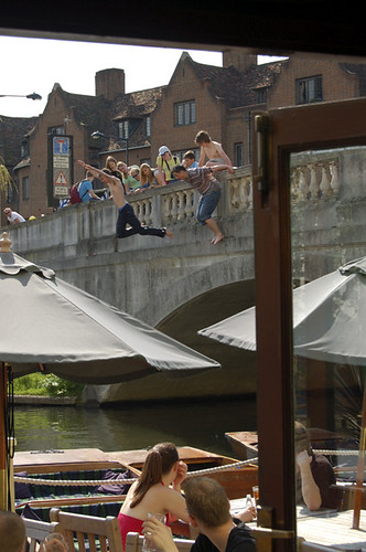 college students diving in the River Cam