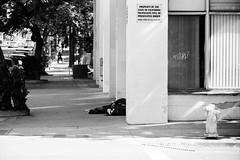 Every Corner Inhabited (Brian Auer) Tags: california street city people urban blackandwhite bw sunlight film corner outside person 50mm town blackwhite unitedstates sandiego outdoor sleep homeless naturallight fujifilm neopan grayscale asa400 minoltasrtsuper 135format negativebwfilm
