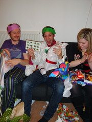 Russ' presents include grasshopers (Thais Delcanton) Tags: christmas party sarah 2008 espe darrensimpson florry jamieboyd russchimes clairemorris thaisdelcanton robsargeant samsammons andreasbonnell sophiehodges