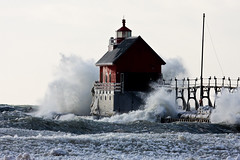 Battered (James Marvin Phelps) Tags: winter lighthouse outdoors photography waves michigan great lakes lakemichigan jmp grandhavenmichigan mandj98 jamesmarvinphelps grandhavenpierlight