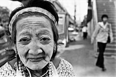 "bag lady #4 - Bangkok, city of angels (Sailing ""Footprints: Real to Reel"" (Ronn ashore)) Tags: street city portraits chalk women faces bangkok trix poor nikonf3 interaction streetperson baglady ameeting nikkor45mmf28p anencounter 0925f3trixnikkor45mmf28pfilm0161sanscontactsheetbkk 0925f3trixnikkor45mmf28pfilm0161sanscontactsheet"
