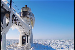 St. Joseph Lighthouse in Winter (Tom Gill.) Tags: winter lighthouse lake snow ice pier frozen michigan stjoseph lakemichigan icicles rangelight stjosephmichigan lighthousetrek outerrangelight