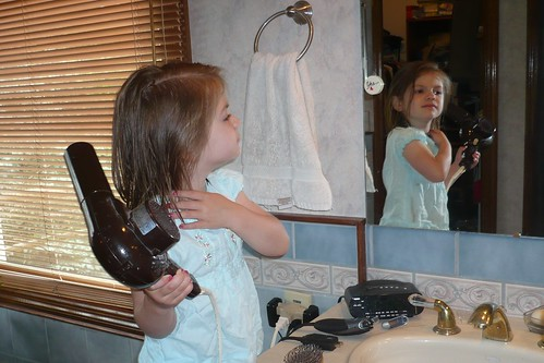 Alana drying her hair for special luncheon