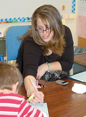 Slater reading specialist Angie Halvorson helps a student with a worksheet. (Photo by LAUREN BROWN)