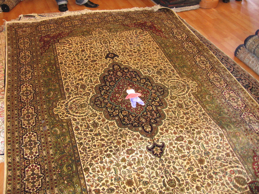 On a handmade silk rug