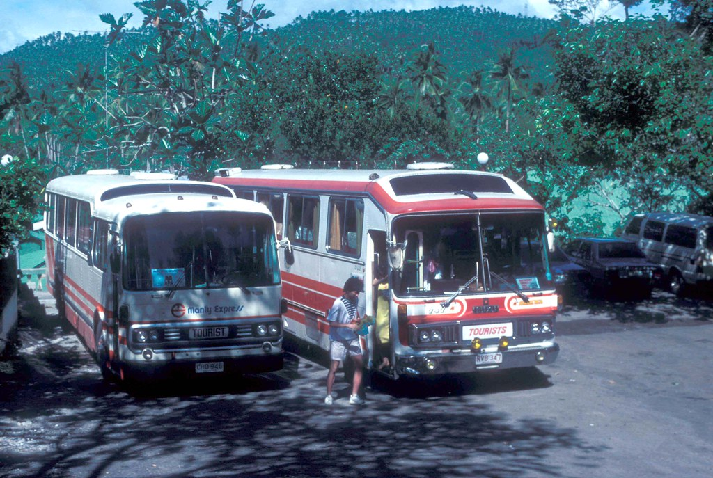 Manly Express Mitsubishi (Fuso) for Coach CHD-946 and Department of Tourism for (Rajah Tours) Isuzu Coach NVB-347 outside the Falls Lodge, Pagsanjan, Philippines.
