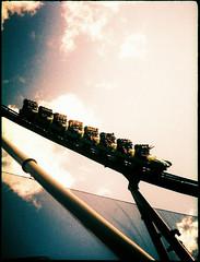 Islands of Xpro Adventure (vivoandando) Tags: usa film america pen orlando lomo xpro lomography crossprocessed experimental cross florida slide olympus crossprocessing frame half rollercoaster filme 135 halfframe expired 35 processed estadosunidos islandsofadventure processo lomografia fujivelvia100f cruzado flrida vencido
