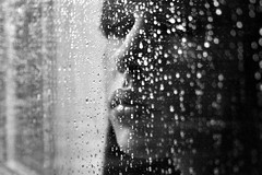 Cause it's always raining in my head. (miah.) Tags: portrait blackandwhite selfportrait blur face rain glitter nose bokeh naturallight lips explore sp mia raindrops explord