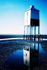 A sense of perspective... (Trapac) Tags: uk blue autumn england lighthouse white reflection film beach water puddle wooden xpro crossprocessed child mud legs piers 9 somerset olympus slidefilm xa2 agfa olympusxa2 foreshore burnhamonsea tideout 100iso ctprecisa precisa wmh sedgemoor agfactprecisa gradeiilisted burnhamlighthouse lowlighthouse olympusxa2roll8 lighthouseonlegs burnhamonsealighthouse