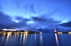 winter sky over chania:  29/365 (helen sotiriadis) Tags: blue winter sea sky moon lighthouse reflection night canon lights harbor creta greece crete canon350d astronomy 365 canonrebelxt hdr chania  canonefs1022mmf3545usm photomatix      toomanytribbles