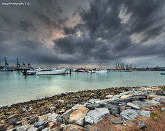 Monsoons over my PLANET ! (Ragstatic) Tags: city longexposure morning light sunset sea sky sun seascape color reflection beach water clouds sunrise relax landscape happy dawn photo nikon singapore rocks exposure nightshot searchthebest rags famous photograph dri hdr stockphoto blending d700 singaporelandscape singaporenightshot singaporeseascape
