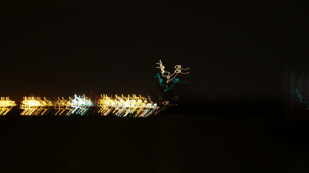 Squiggle lights of tug boat & cranes