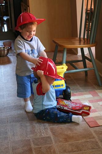 Walker Helping Eli Get His Hat On