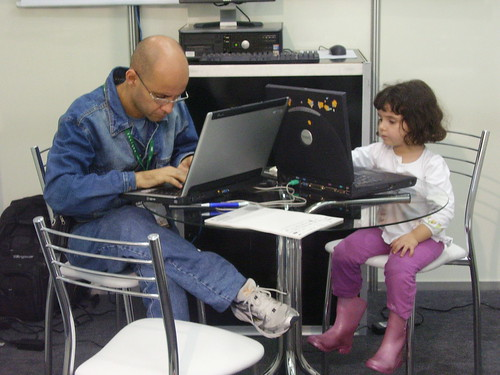 Man and child using their laptops