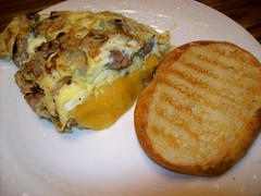Bring it (julie_starr_mccloud) Tags: food cheese breakfast bread mushrooms shiny plate onions butter eggs pan hungry sis cooked grilled cheddar thick omelette scrambled dense appetite turkeysausage hitsthespot omelettegoddess