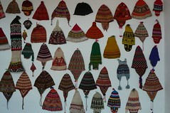 Hats on a Wall (jookdal) Tags: colors wall mix caps hats bolivia assortment mitten earflaps