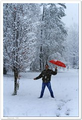 Taking a Yardwalk! (Mr. Greenjeans) Tags: snow home nature umbrella louisiana moments seasons thesouth mrgreenjeans gaylon canonef28135mmf3556isusm yardwalk hohohohat redsticklive gaylonkeeling
