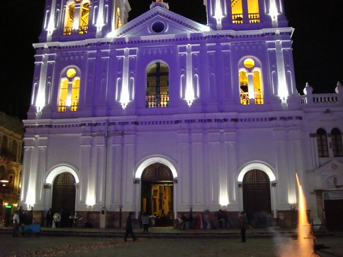 Fireworks in front of an illuminated Cuenca church....