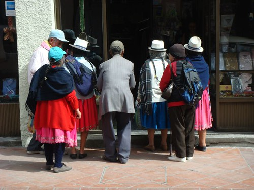 Begging indians in front of a shop in Cuenca...