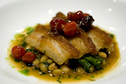 Close up of the Pork belly with coco beans, oloroso sherry and cranberries