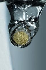 When the money plunges (edouardv66) Tags: 2 color macro 50mm switzerland frozen coin nikon suisse geneva flash experiment drop explore nikkor genève euros plunge watter strobist d700