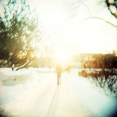 come identify yourself, child of light (sciencesque) Tags: winter sun snow blur 120 film mediumformat square person holga xpro crossprocessed kodak overexposed e100vs bulbsetting cfn