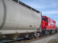 A bright red EMD switcher on a CP Rail switching local. Franklin Park Illinois. October 2007.