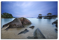 The Muted Sunrise (DanielKHC) Tags: longexposure sea digital sunrise island interestingness high nikon singapore rocks dynamic rags jetty explore bec range dri increase hdr pulau blending ubin d300 sigma1020mm dynamicrangeincrease nd400 interestingness406 3exp explore14jun06 danielcheong infinestyle danielkhc bacikisseskusse