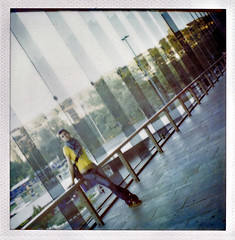 awaiting at budapest (Lma) Tags: film girl lines yellow analog polaroid sx70 stand budapest expired 2008 pola plm tisza srga lny dli plyaudvar miletics lma plma ll