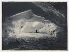 Cavern carved by the sea in an ice wall near Commonwealth Bay, 1911-1914 (State Library of New South Wales collection) Tags: light shadow man cold ice expedition silhouette dark underground person one bay cool darkness explorer inspired antarctica erosion cave 1910s exploration caverns cavern commonwealth icecaves australasian antarctic icecave surgeon silvergelatin statelibraryofnewsouthwales frankhurley commonwealthbay whetter cavernadighiaccio drlesliewhetter badosa:obra=n056 bluetonedgelatinsilver lesliehwhetter commons:event=commonground2009