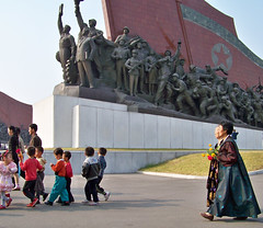 Women and Children at the Kim Il-Sung Monument (Ray Cunningham) Tags: tourism monument del children women republic kim north korea tourist peoples communist communism american socialist democratic socialism norte northkorea realism pyongyang core corea dprk koryo ilsung nordkorea      raycunningham raymondcunningham zaruka raymondkcunninghamjr raymondkcunninghamjr