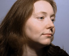 Mona Lisa Smile (Galen's Photography) Tags: portrait woman closeup profile softtones cannona10000
