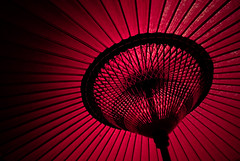 Couldn't resist to post another red japanese parasol (manganite) Tags: red topf25 colors japan digital umbrella dark paper geotagged sensoji tokyo interestingness topf50 nikon colorful asia tl buddhism explore parasol temples getty  onecolor nippon  d200 asakusa nikkor dslr umbrellas vignette nihon kanto gettyimages thecolorred interestingness483 i500 18200mmf3556 utatafeature manganite nikonstunninggallery aplusphoto date:year=2006 date:month=august geo:lat=35712137 geo:lon=139796305 date:day=28 format:ratio=32