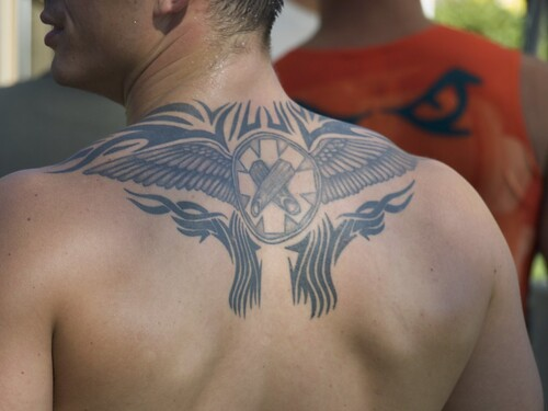 Dungeon Shoulder · Tribal Wings and Crossed Fingers Tattoo