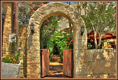 Syrian Club Restaurant Entrance (Mike G. K.) Tags: wood flowers trees plants sunlight stone club mailbox restaurant gate arch shadows path entrance cyprus frame round lamps noon hdr syrian nicosia photomatix 3exp theartistseyes