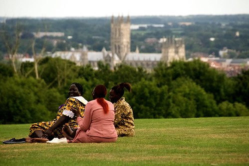 Some spouses enjoy the weather and the view of Canterbury Cathedral. ACNS/Gunn